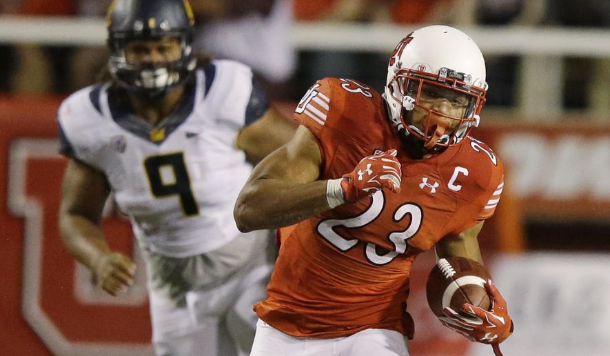 Utah running back Devontae Booker (23) carries the ball while being pursued by California defensive tackle James Looney (9) in the first half during an NCAA college football game Saturday, Oct. 10, 2015, in Salt Lake City. (AP Photo/Rick Bowmer)