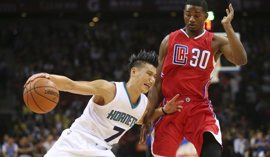 The Charlotte Hornets guard Jeremy Lin drives past Los Angeles Clippers guard CJ Wilcox during the fourth quarter of the 2015 NBA Global Games in Shenzhen, south China's Guangdong province, Sunday, Oct. 11, 2015. (AP Photo/Kin Cheung)