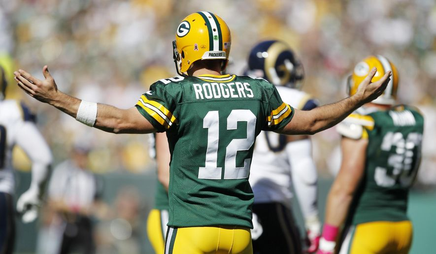 Green Bay Packers' Aaron Rodgers reacts during the first half an NFL football game against the St. Louis Rams Sunday, Oct. 11, 2015, in Green Bay, Wis. (AP Photo/Matt Ludtke)