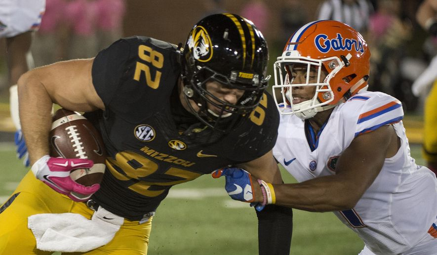 Missouri tight end Clayton Echard, left, is tackled by Florida's Vernon Hargreaves III during the first half of an NCAA college football game, Saturday, Oct. 10 2015, in Columbia, Mo. (AP Photo/L.G. Patterson)