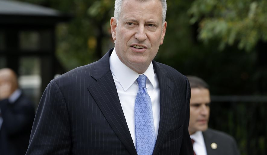 FILE - In this Monday, Sept. 21, 2015, file photo, New York City Mayor Bill de Blasio arrives at City Hall in New York. The political organization founded by de Blasio will be hosting a bipartisan presidential forum on income inequality in December 2015 in Iowa. (AP Photo/Seth Wenig, File)