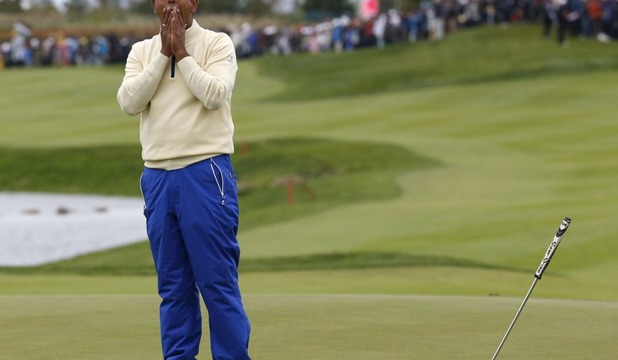 International team player Anirban Lahiri of India reacts on the 18th green after missing a putt to lose his match against United States' Chris Kirk in their singles match at the Presidents Cup golf tournament at the Jack Nicklaus Golf Club Korea, in Incheon, South Korea, Sunday, Oct. 11, 2015.(AP Photo/Lee Jin-man)