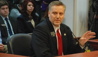 South Dakota House Speaker Brian Gosch, R-Rapid City, talks Wednesday, Feb. 5, 2014, in Pierre, S.D., about his proposal to ban texting while driving statewide. The House Judiciary Committee delayed a vote on the measure until Monday.  (AP Photo/Chet Brokaw)
