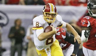 Atlanta Falcons outside linebacker O'Brien Schofield (50) attempts the tackle on Washington Redskins quarterback Kirk Cousins (8) during the first half of an NFL football game, Sunday, Oct. 11, 2015, in Atlanta. (AP Photo/Brynn Anderson)