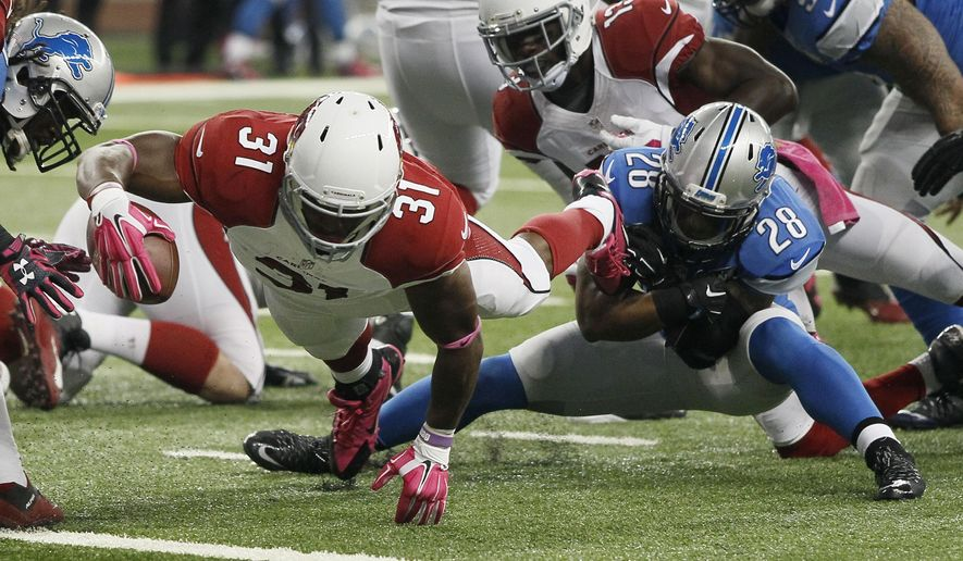 Arizona Cardinals running back David Johnson (31) pulls away from Detroit Lions cornerback Quandre Diggs (28) for a touchdown during the first half of an NFL football game, Sunday, Oct. 11, 2015, in Detroit. (AP Photo/Duane Burleson)