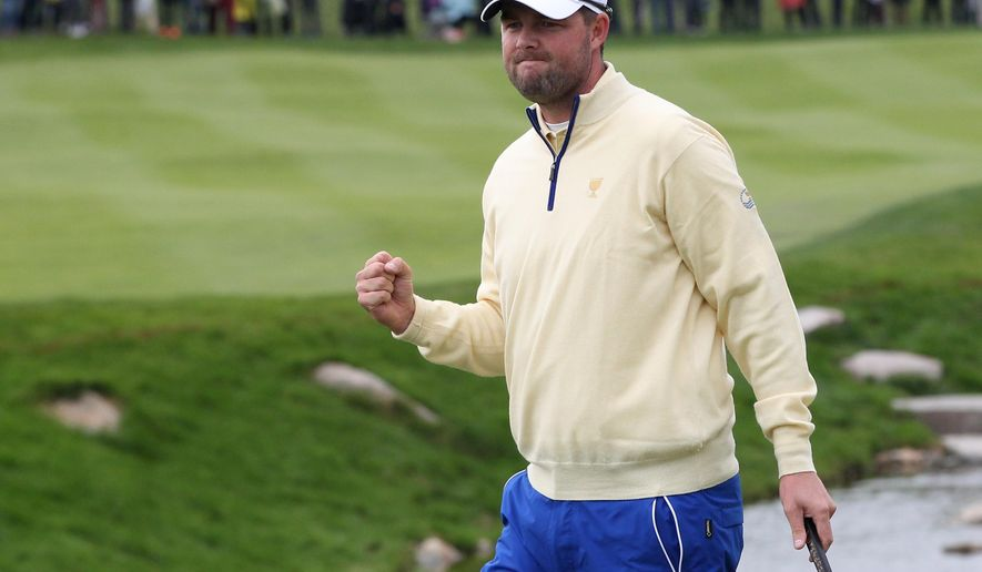 International team player Marc Leishman of Australia reacts after winning a hole during his singles match against United States' Jordan Spieth at the Presidents Cup golf tournament at the Jack Nicklaus Golf Club Korea, in Incheon, South Korea, Sunday, Oct. 11, 2015.(AP Photo/Ahn Young-joon)
