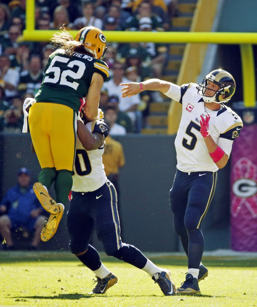 Green Bay Packers' Clay Matthews (52) applies pressure as St. Louis Rams quarterback Nick Foles (5) throws during the first half an NFL football game Sunday, Oct. 11, 2015, in Green Bay, Wis. (AP Photo/Mike Roemer)