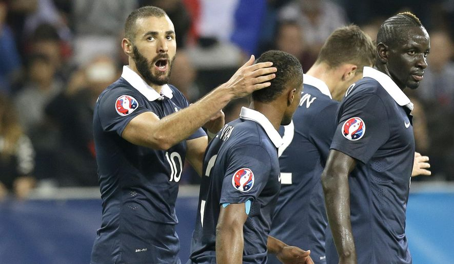 France's Karim Benzema rescts after storing the third goal against Armenia during their friendly soccer match in the stadium of Nice, southeastern France, Thursday, Oct. 8, 2015. (AP Photo/Lionel Cironneau)