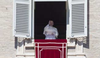 Pope Francis delivers his blessing during the Angelus noon prayer he celebrated from the window of his studio overlooking St. Peter's Square at the Vatican, Sunday, Oct. 11, 2015. (AP Photo/Andrew Medichini)