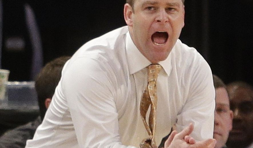 FILE - In this Jan. 21, 2015, file photo, Marquette head coach Steve Wojciechowski calls to his team during the first half of an NCAA college basketball game against St. John's in New York. There are so many fresh faces at Marquette that it might seem like Wojciechowski is going through a second rookie year as a head coach. (AP Photo/Frank Franklin II, File)