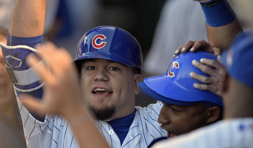 Chicago Cubs left fielder Kyle Schwarber celebrates in the dugout after hitting a home run against the St. Louis Cardinals during the second inning of Game 3 in baseball's National League Division Series, Monday, Oct. 12, 2015, in Chicago. (AP Photo/Paul Beaty)
