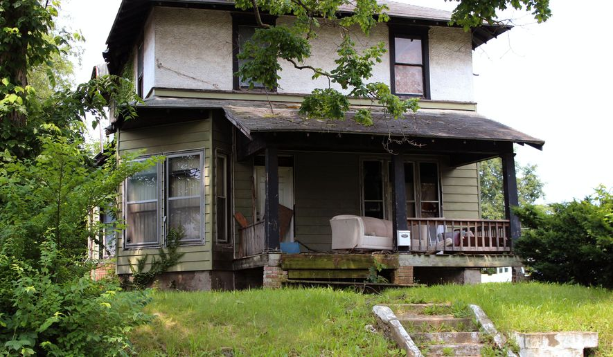 """This July 2, 2015 file photo shows the childhood home of actor Dick Van Dyke in Danville, Ill. The 89-year-old actor took to Twitter this week to call attention to the Danville home he and brother Jerry lived in during high school after relocating from Missouri. The star of """"Mary Poppins"""" and television's """"The Dick Van Dyke Show"""" recalled the """"happy memories drifting around in there"""" in a tweet to his 85,200 followers. Van Dyke is taking steps to save the house, which was slated for demolition. (Tracy Moss/News-Gazette via AP, File)"""