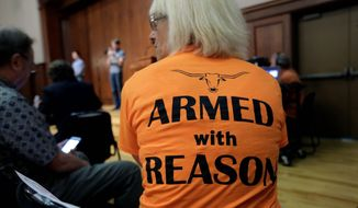 Ann Cvetkovich, a professor, attends a Sept. 30, 2015, forum in Austin, Texas, about a new law that allows students with concealed weapons permits to carry firearms into class and other campus buildings. (Associated Press) **FILE**