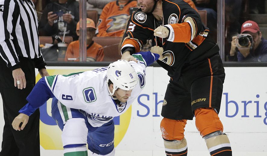 Anaheim Ducks' Clayton Stoner, right, fights with Vancouver Canucks' Brandon Prust during the first period of an NHL hockey game, Monday, Oct. 12, 2015, in Anaheim, Calif. (AP Photo/Jae C. Hong)