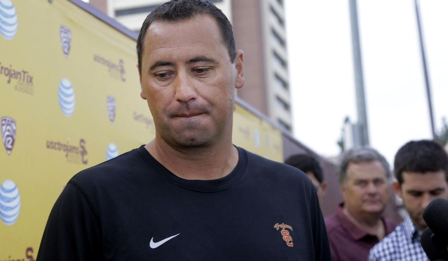 FILE - In this Aug. 25, 2015, file photo, Southern California NCAA college football head coach Steve Sarkisian speaks to members of the media before practice on the campus in Los Angeles. USC fired Sarkisian one day after the troubled coach was put on leave. Athletic director Pat Haden announced his decision Monday, Oct. 12, 2015, in a brief statement. (AP Photo/Nick Ut, File)