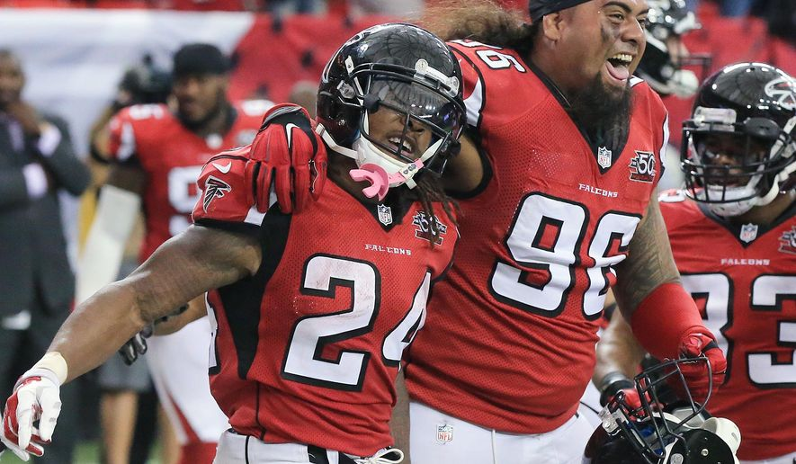 Atlanta Falcons running back Devonta Freeman, left, celebrates his touchdown with Paul Soliai for a 19-16 lead over the Washington Redskins during the fourth quarter of an NFL football game, Sunday, Oct. 11, 2015 in Atlanta. (Curtis Compton/Atlanta Journal-Constitution via AP)  MARIETTA DAILY OUT; GWINNETT DAILY POST OUT; LOCAL TELEVISION OUT; WXIA-TV OUT; WGCL-TV OUT; MANDATORY CREDIT