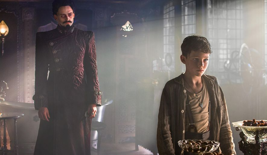 "This image released by Warner Bros. Pictures shows Levi Miller, right, and Hugh Jackman in a scene from the film, ""Pan."" (Laurie Sparham/Warner Bros. Pictures via AP)"