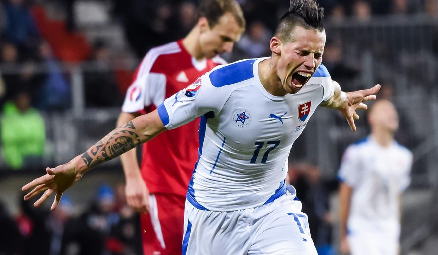 Slovakia's Marek Hamsik celebrates after scoring during a Group C Euro 2016 qualifying soccer match between Luxembourg and Slovakia at the Josy Barthel stadium in Luxembourg on Monday, Oct. 12, 2015. (AP Photo/Geert Vanden Wijngaert)