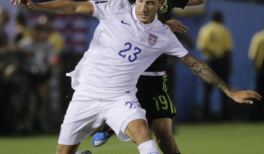 United States' Fabian Johnson (23) is challenged by Mexico's Oribe Peralta during the CONCACAF Cup soccer match at the Rose Bowl Stadium, in Pasadena , Calif. Saturday, Oct. 10, 2015, (AP Photo/Jae C. Hong)