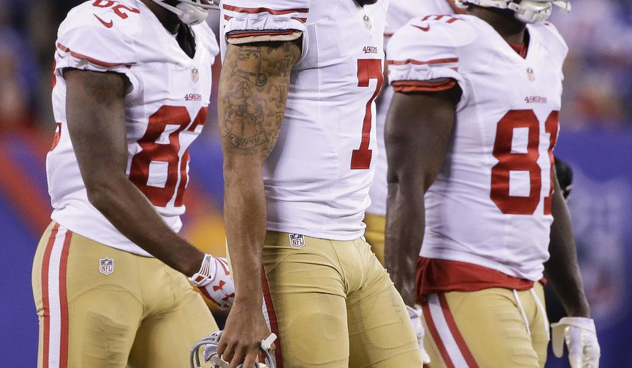 San Francisco 49ers quarterback Colin Kaepernick (7) walks off the field with wide receiver Torrey Smith (82) and wide receiver Anquan Boldin (81) during the fourth quarter of an NFL football game against the New York Giants, Sunday, Oct. 11, 2015, in East Rutherford, N.J. (AP Photo/Seth Wenig)