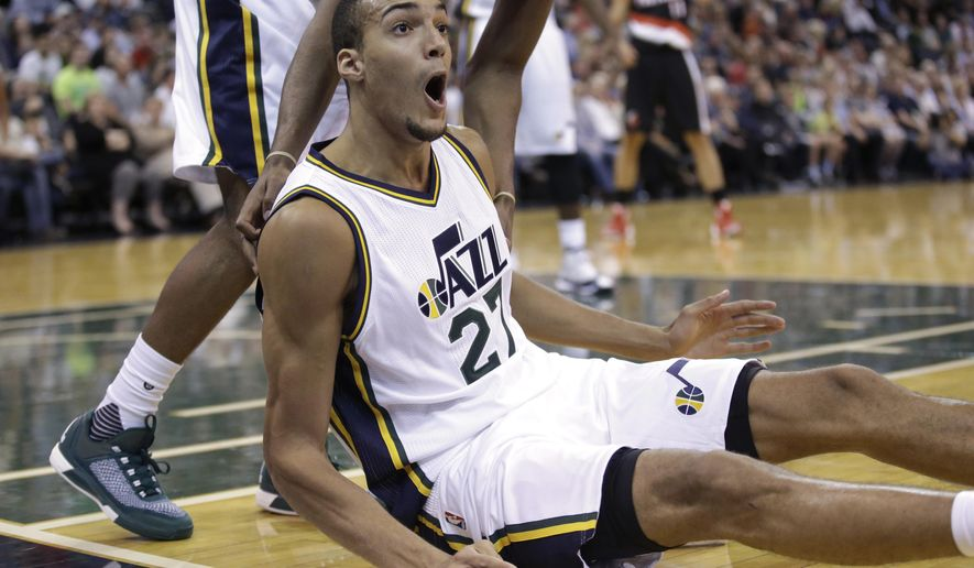 Utah Jazz's center Rudy Gobert (27) reacts to  a call during the second quarter of an NBA preseason basketball game against the Portland Trail Blazers, Monday, Oct. 12, 2015, in Salt Lake City. (AP Photo/Rick Bowmer)