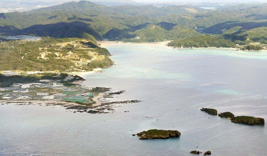 This Aug. 13, 2015 photo shows an aerial view of Henoko coast of Nago city, Okinawa, southern Japan. Okinawa Gov. Takeshi Onaga on Tuesday, Oct. 13, 2015, revoked approval for work needed to relocate a U.S. air base from one area of the southern Japanese island to another, though the Tokyo government said it plans to proceed with the plan anyway. (Yu Nakajima/Kyodo News via AP) JAPAN OUT, CREDIT MANDATORY