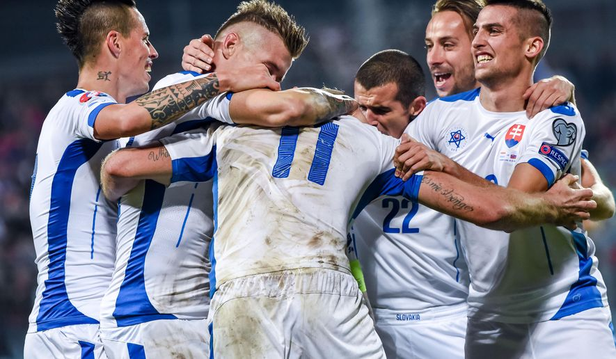 Slovakia's Adam Nemec, center, celebrates with teammates after scoring during a Group C Euro 2016 qualifying soccer match between Luxembourg and Slovakia at the Josy Barthel stadium in Luxembourg on Monday, Oct. 12, 2015. (AP Photo/Geert Vanden Wijngaert)