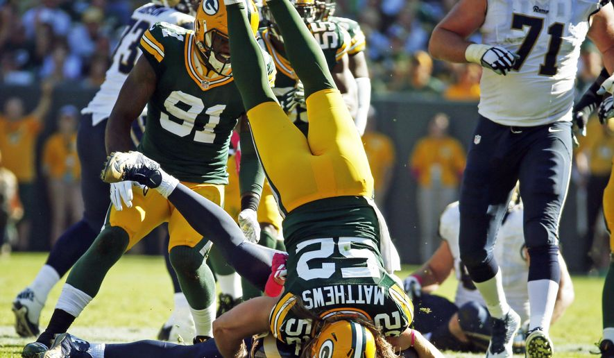 Green Bay Packers' Clay Matthews sacks St. Louis Rams quarterback Nick Foles during the second half an NFL football game Sunday, Oct. 11, 2015, in Green Bay, Wis. The Packers won 24-10. (AP Photo/Mike Roemer)