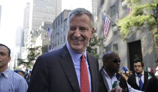 New York City Mayor Bill de Blasio winks at someone during the Columbus Day Parade in New York, Monday, Oct. 12, 2015. Approximately 35,000 marchers participated in the annual celebration of Italian-American culture. (AP Photo/Seth Wenig) ** FILE **