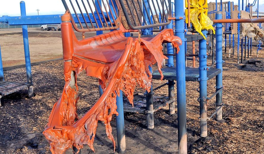 Melted playground equipment stands outside Cannon Ball Elementary after a prairie fire, Monday, Oct. 12, 2015. (Tom Stromme/Bismarck Tribune via AP) MANDATORY CREDIT