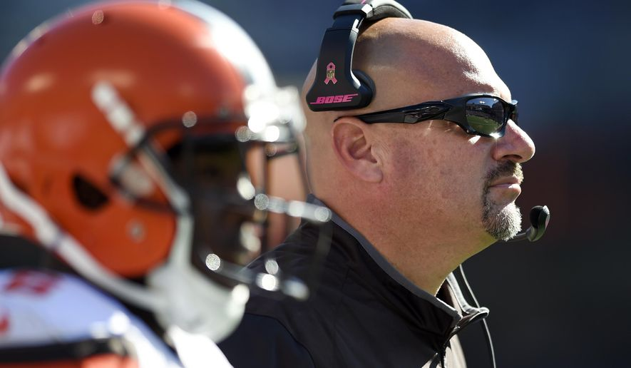 Cleveland Browns head coach Mike Pettine stands on the sideline in the first half of an NFL football game against the Baltimore Ravens, Sunday, Oct. 11, 2015, in Baltimore. Cleveland won 33-30 in overtime. (AP Photo/Gail Burton)