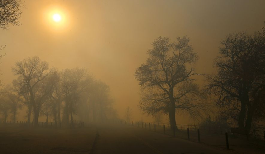 In this Sunday, Oct. 11, 2015, photo, heavy smoke rests at Edness Kimball Wilkins State Park near Evansville, Wyo. The fast-moving grass fire that started at a landfill destroyed an unknown number of homes and other buildings and forced hundreds of people to evacuate from a rural area in Wyoming. (Alan Rogers/The Casper Star-Tribune via AP) MANDATORY CREDIT