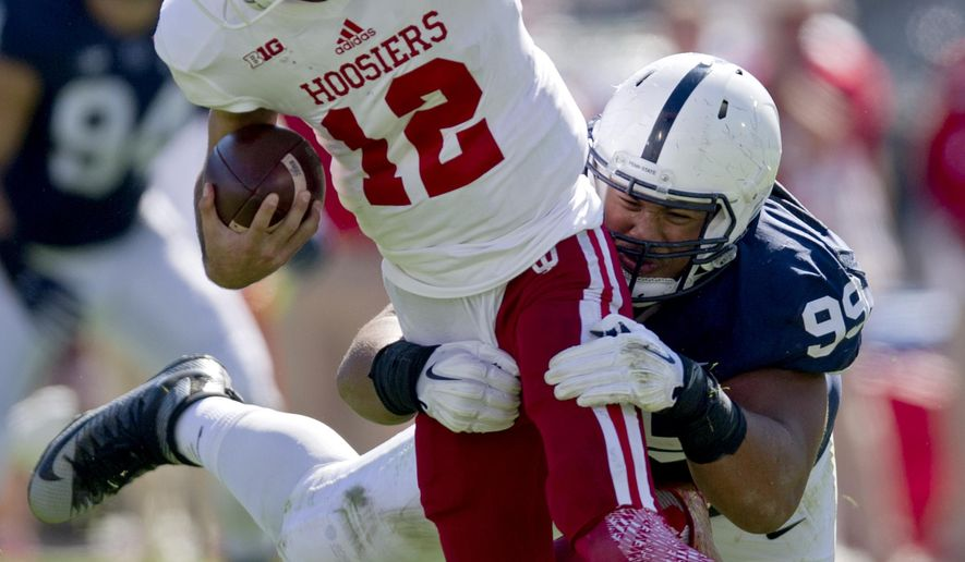 Penn State defensive tackle Austin Johnson pulls down Indiana quarterback Zander Diamont during an NCAA college football game, Saturday, Oct. 10, 2015, in State College, Pa. (Abby Drey/Centre Daily Times via AP) MANDATORY CREDIT; MAGS OUT   MBI