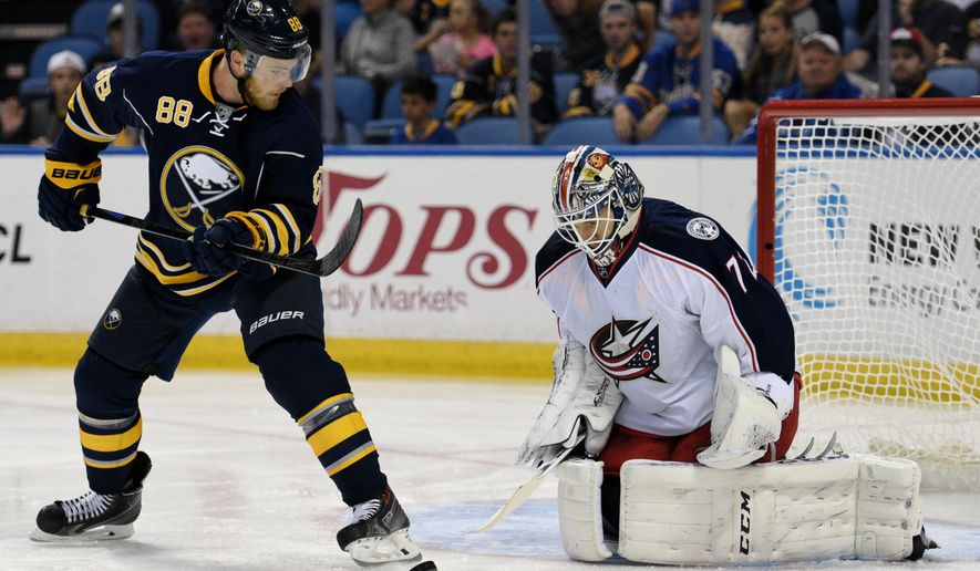 Buffalo Sabres left winger Jamie McGinn (88) backhands the puck on Columbus Blue Jackets goaltender Sergi Bobrovsky (72) during the first period of an NHL hockey game, Monday, Oct.12, 2015, in Buffalo, N.Y. (AP Photo/Gary Wiepert)
