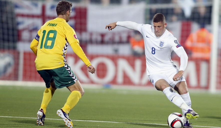Lithuania's Mindaugas Panka , left, and England's Ross Barkley  challenge for the ball during the Euro 2016 group E qualifying soccer match between the Lithuania and England at the LFF stadium in Vilnius, Lithuania, Monday, Oct. 12, 2015. (AP Photo/Mindaugas Kulbis)