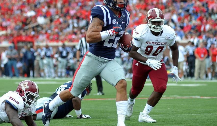 Mississippi running back Jordan Wilkins (22) runs 11-yards for a touchdown against New Mexico State during the first half of an NCAA college football game at Vaught-Hemingway Stadium in Oxford, Miss. on Saturday, Oct. 10, 2015. (Bruce Newman/The Oxford Eagle via AP)