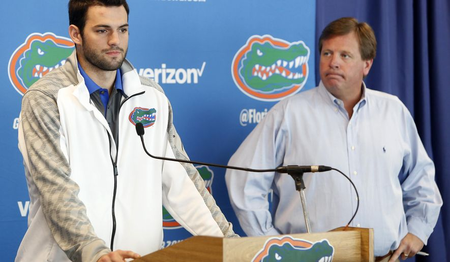 Florida Gators quarterback Will Grier, left, speaks to members of the media as head coach Jim McElwain listens Monday, Oct. 12, 2015, in Gainesville, Fla. Grier has been suspended indefinitely for violating the NCAA's policy on banned performance-enhancing drugs. The school announced the suspension at the news conference on Monday. Grier, who failed a drug test, said he took an over-the-counter supplement. (Matt Stamey/The Gainesville Sun via AP)  THE INDEPENDENT FLORIDA ALLIGATOR OUT; MANDATORY CREDIT