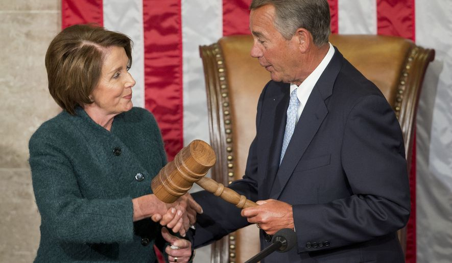 House Speaker John Boehner of Ohio, right, is handed the gavel from House Minority Leader Nancy Pelosi, D-Calif, left, after being re-elected for a third term to lead the 114th Congress, as Republicans assume full control for the first time in eight years, at the Capitol in Washington, Tuesday, Jan. 6, 2015. (AP Photo/Pablo Martinez Monsivais )