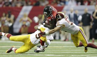 Atlanta Falcons wide receiver Julio Jones (11) makes the catch against Washington Redskins inside linebacker Will Compton (51) during the second half of an NFL football game, Sunday, Oct. 11, 2015, in Atlanta. (AP Photo/Brynn Anderson)