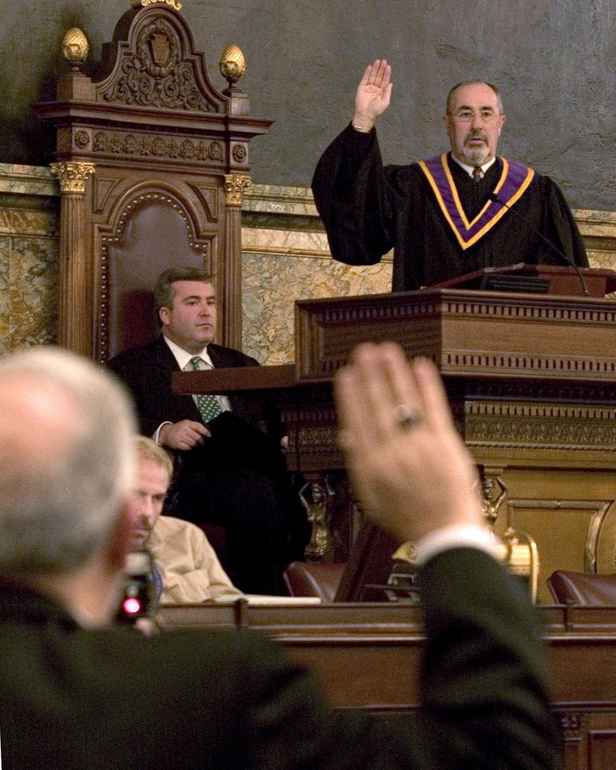 """FILE - In this  Dec. 13, 2004, file photo, Pennsylvania Supreme Court Justice J. Michael Eakin recites the oath of office during the proceedings of the 55th Pennsylvania Electoral College at the State Capitol in Harrisburg, Pa. The court's justices said in a Monday, Oct. 12, 2015, statement they were """"disturbed"""" by media reports about an alleged email exchange of explicit photos or offensive jokes between Eakin and prosecutors. (AP Photo/Daniel Shanken, File)"""