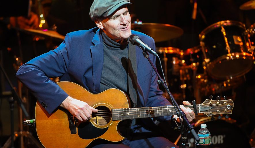 FILE - In this Jan. 20, 2015 file photo, James Taylor performs at the Nearness of You concert at Jazz at Lincoln Center in New York. Taylor posted on his website that his mother, Gertrude Woodard Taylor, died  over the weekend on Martha's Vineyard.  She was 92. (Photo by Scott Roth/Invision/AP, File)