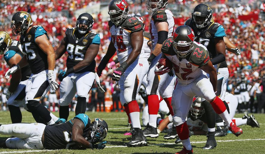 Tampa Bay Buccaneers running back Doug Martin (22) runs for a touchdown against the Jacksonville Jaguars during the first half of an NFL football game, Sunday, Oct. 11, 2015 in Tampa, Fla. (Corey Perrine/Naples Daily News via AP)  FORT MYERS OUT; MANDATORY CREDIT