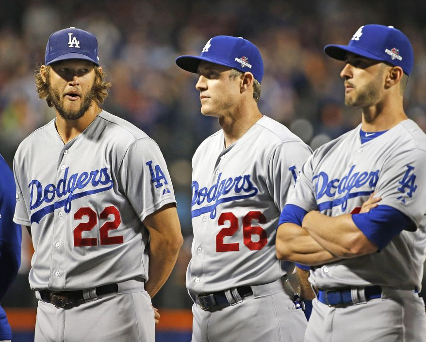 Los Angeles Dodgers pitcher Clayton Kershaw (22) glances at Los Angeles Dodgers' Chase Utley (26) as the crowd boos Utley during baseline introductions for baseball's Game 3 of the National League Division Series against the New York Mets, Monday, Oct. 12, 2015, in New York. Utley was disciplined for sliding hard into New York Mets' Ruben Tejada in Game 2, causing Tejada to break his leg. (AP Photo/Kathy Willens)