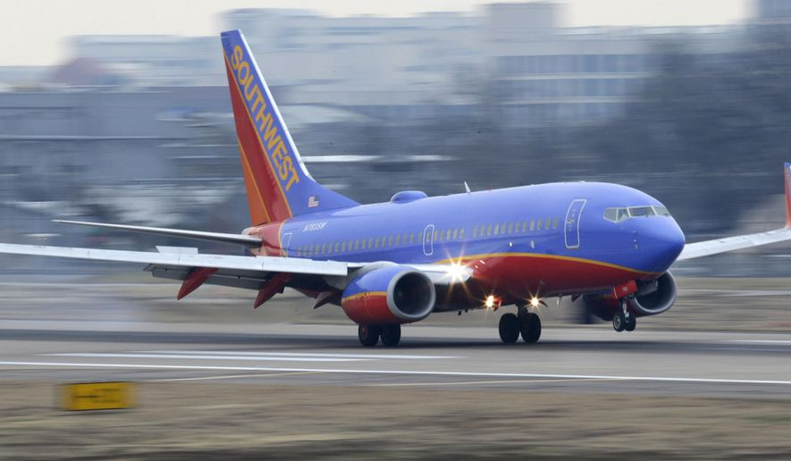 FILE - In this Feb. 3, 2014, file photo, a Southwest Airlines jet lands at Love Field in Dallas. Southwest Airlines said Monday, Oct. 12, 2015, that it's fixed the technology problems that delayed hundreds of flights Sunday and that it expects a normal day of operations. (AP Photo/LM Otero, File)
