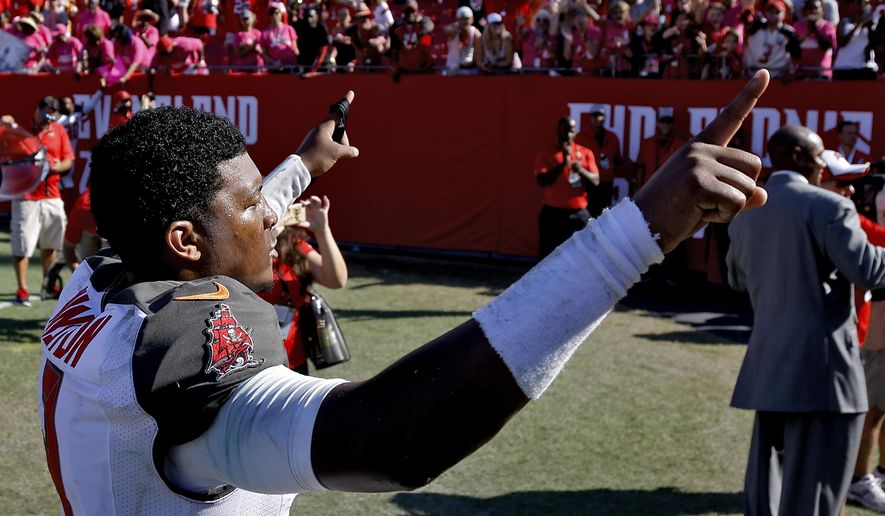 Tampa Bay Buccaneers quarterback Jameis Winston celebrates as he leaves the field following a 38-30 win over the Jacksonville Jaguars during an NFL football game Sunday, Oct. 11, 2015, in Tampa, Fla. (AP Photo/Brian Blanco)