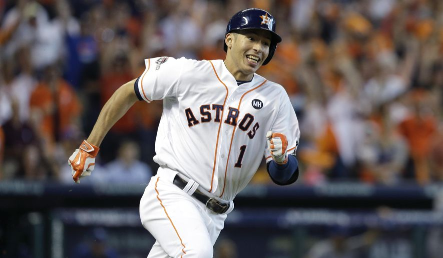 Houston Astros' Carlos Correa (1) races to first base after hitting a single against the Kansas City Royals to score teammate George Springer during Game 4 of baseball's American League Division Series, Monday, Oct. 12, 2015, in Houston. (AP Photo/Pat Sullivan)
