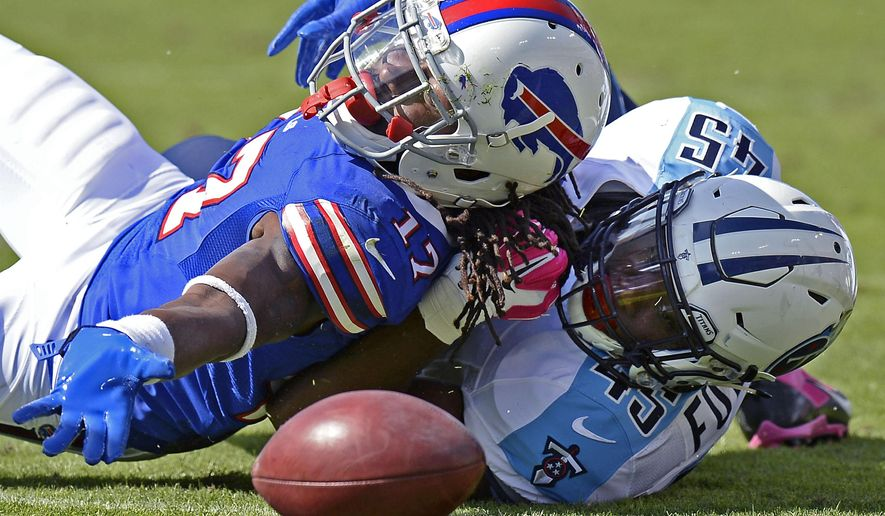 Buffalo Bills wide receiver Denarius Moore (17) fumbles under pressure from Tennessee Titans fullback Jalston Fowler (45) in the second half of an NFL football game Sunday, Oct. 11, 2015, in Nashville, Tenn. (AP Photo/Mark Zaleski)