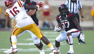 Texas Tech running back Quinton White (37) runs the ball while his teammate Jared Kaster (75) blocks Iowa State's Willie Harvey (16) during an NCAA college football game, Saturday, Oct. 10, 2015, in Lubbock, Texas. Texas Tech won 66-31. (Allison Terry/Lubbock Avalanche-Journal via AP)