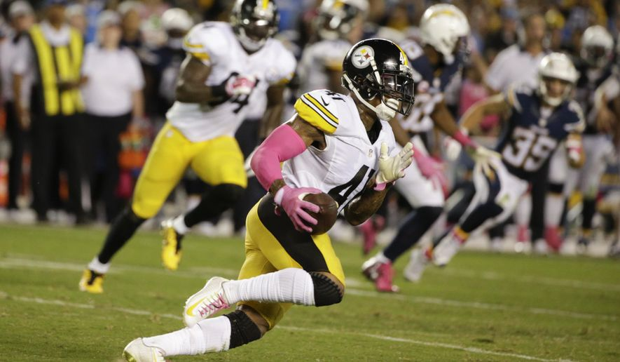 Pittsburgh Steelers cornerback Antwon Blake runs on his way to a touchdown off an interception while playing the San Diego Chargers during the second half of an NFL football game Monday, Oct. 12, 2015, in San Diego. (AP Photo/Lenny Ignelzi)