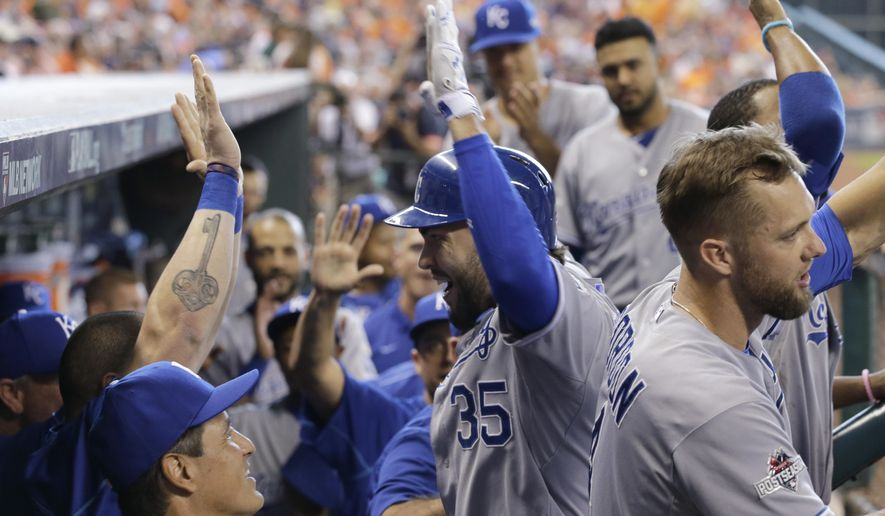 Kansas City Royals' Eric Hosmer, center, celebrates with teammates after his two-run home run against the Houston Astros in the ninth inning during Game 4 of baseball's American League Division Series, Monday, Oct. 12, 2015, in Houston. (AP Photo/David J. Phillip)